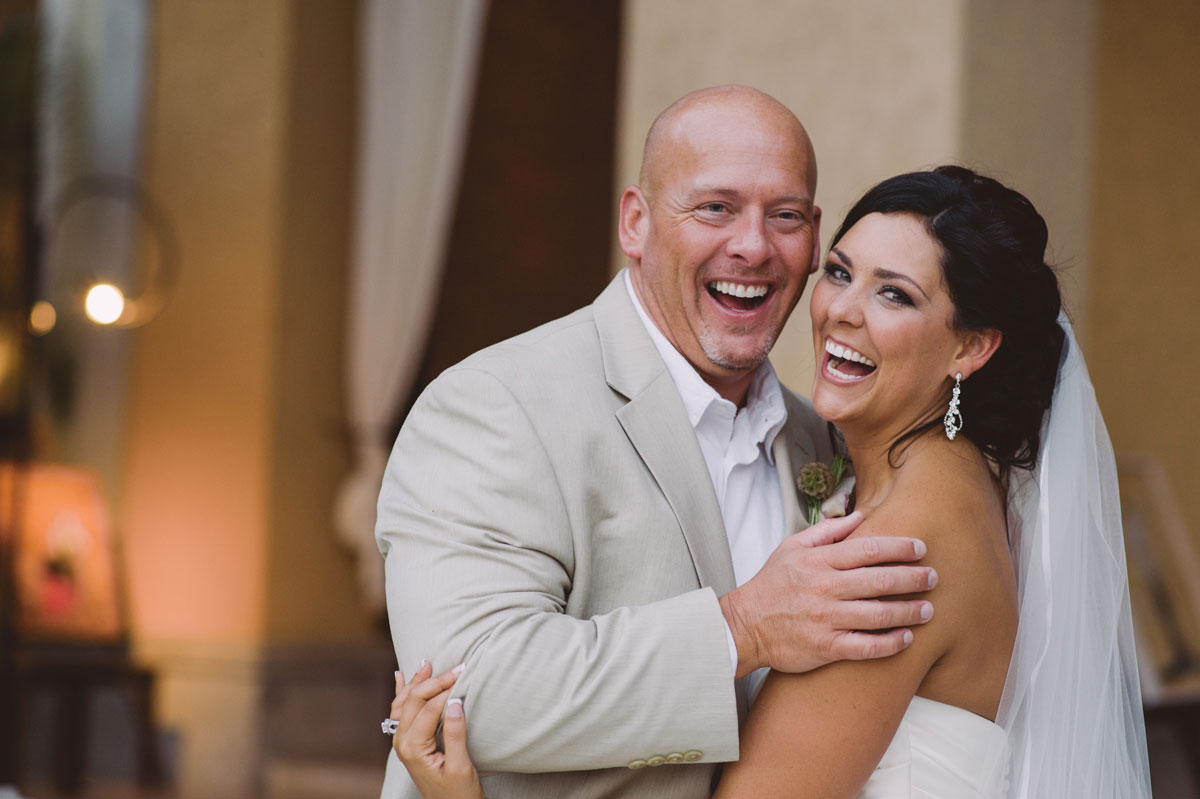Bride and groom laughing together on wedding day