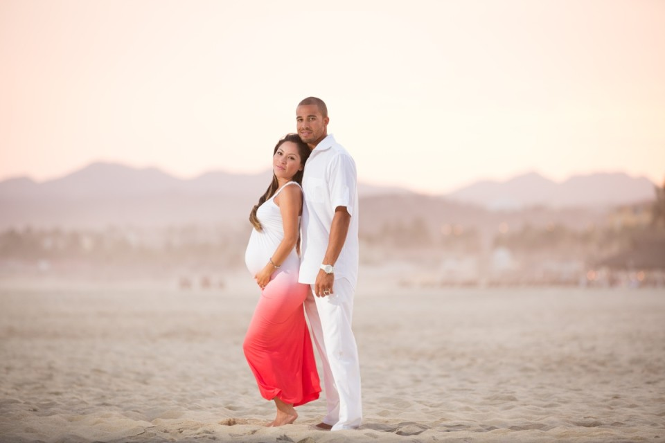 Beach maternity shot of a couple on the beach