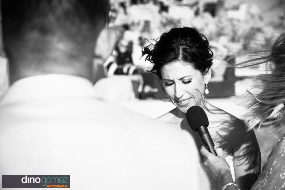Beautiful bride captured in black and white saying her wedding vows