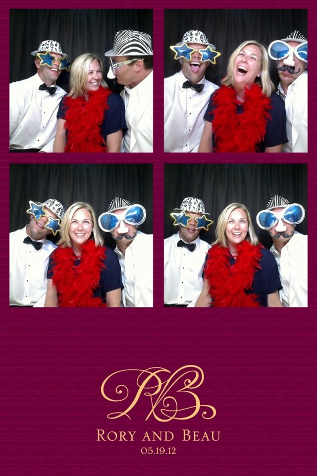 Three wedding guests having fun in a photo booth