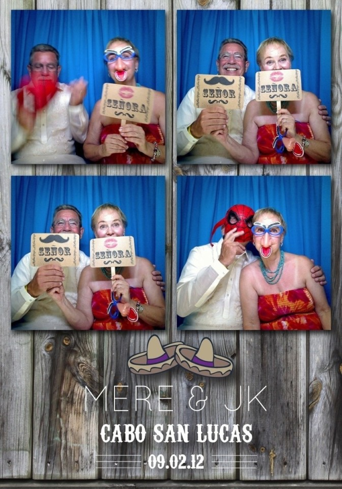 A bride and groom enjoy a photo booth at their destination wedding in mexico