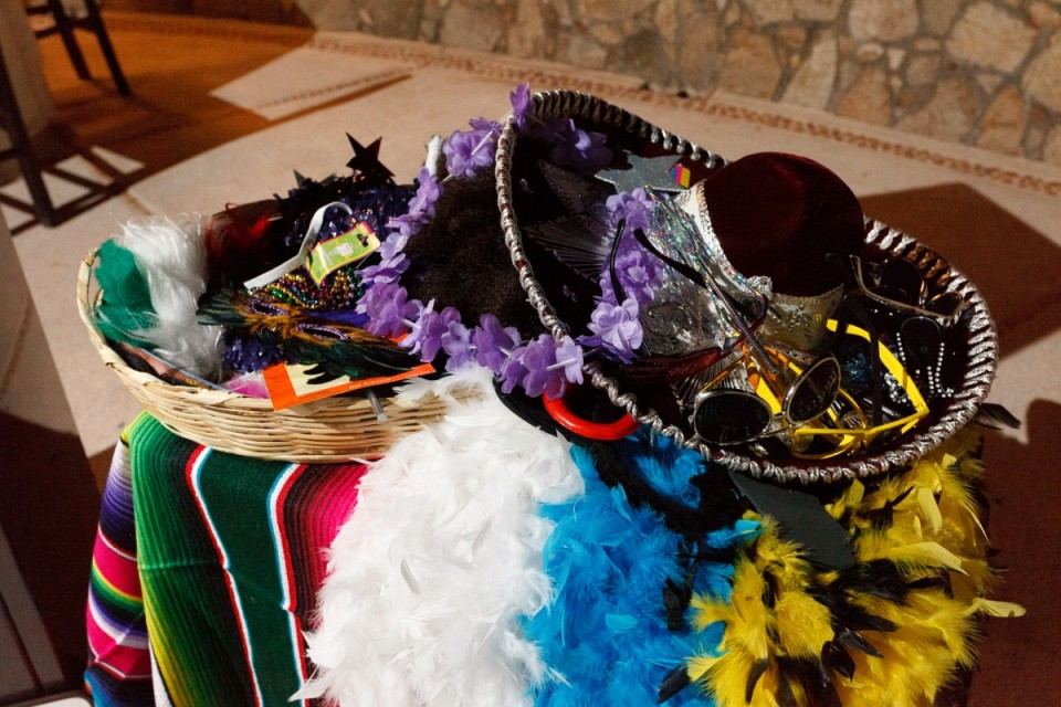 A pile of props ready to be used by guests to create fun photographs