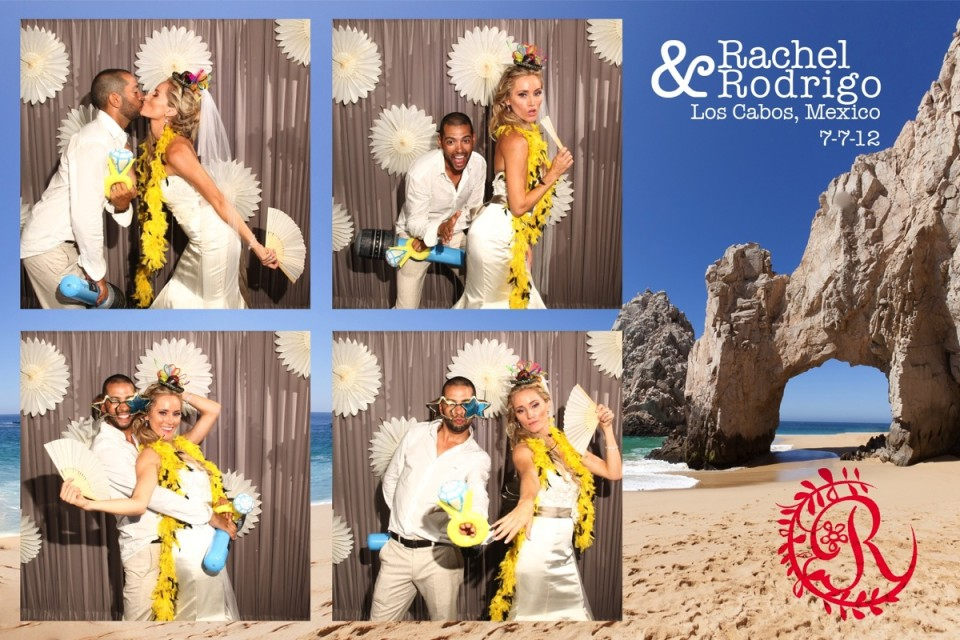 A bride and groom enjoy their destination wedding by using a photo booth provided by Dino Gomez