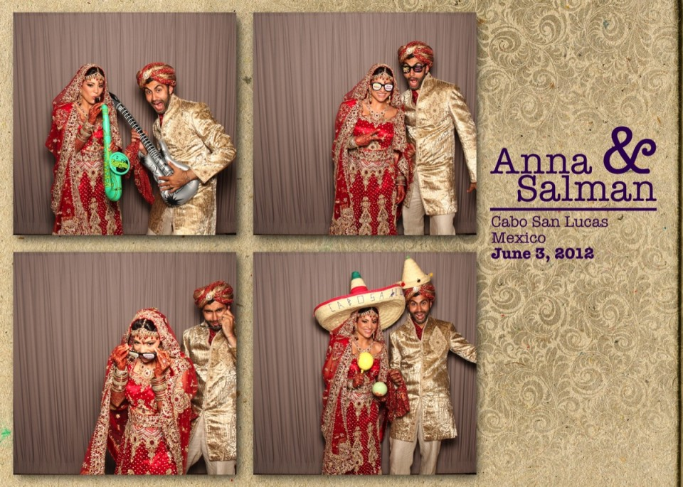 An Indian bride and groom enjoy a photo booth at their destination wedding in Cabo San Lucas