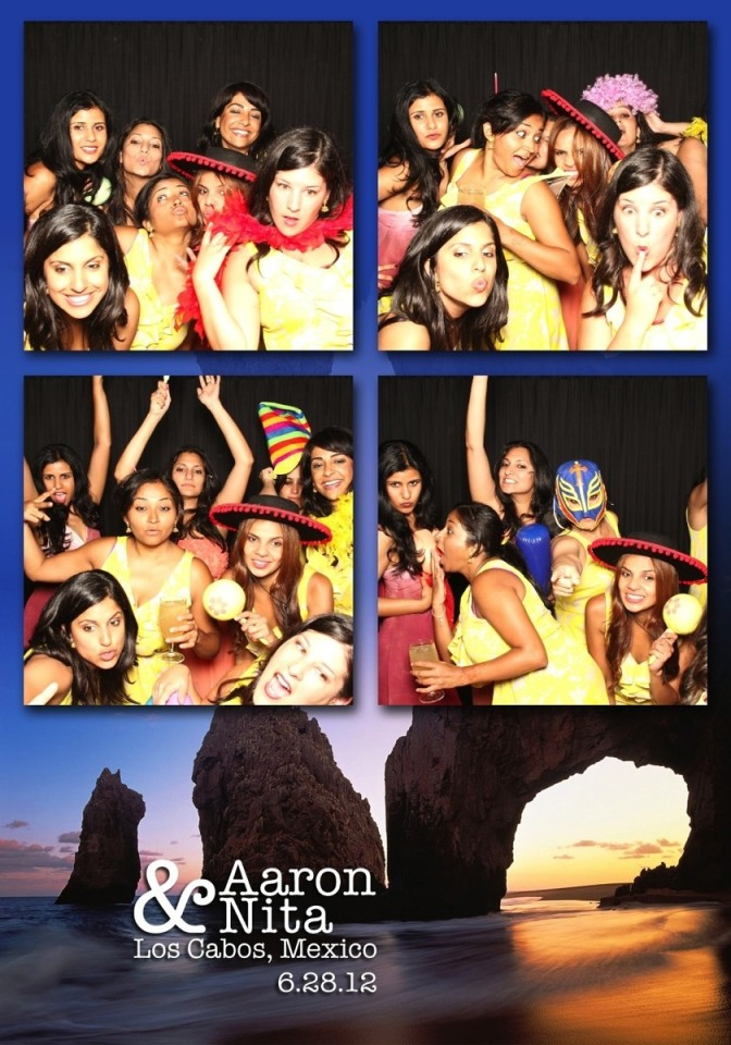 A group of girls use a photo booth to take fun photographs with props in Los Cabos.