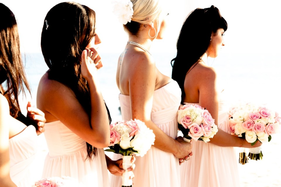 Bridesmaids with flowers in their hands