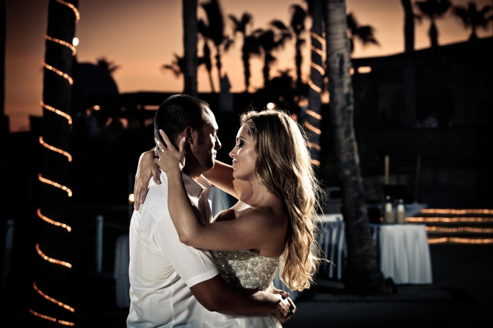 Bride and Groom in an intimate embrace during their first dance at sunset