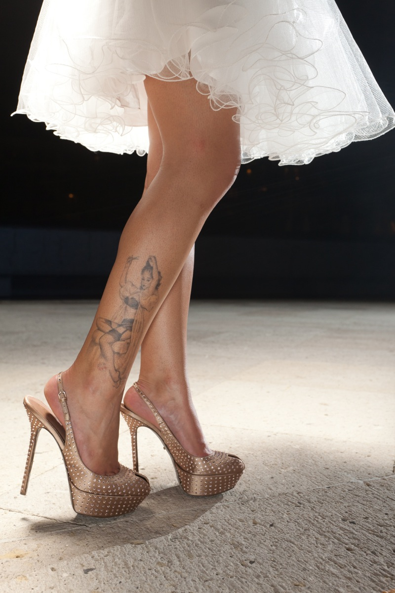 Bride with leg tattoo in golden sling back heels