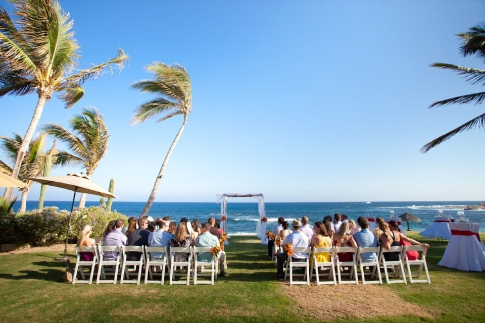 Wedding guests wait for ceremony overlooking the sea in Cancun, Mexico