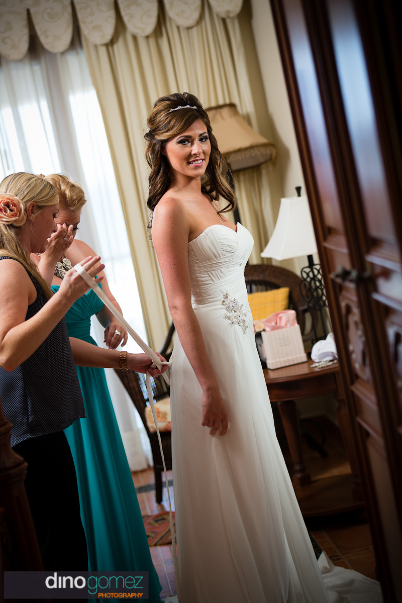 Bride getting help to get ready before the wedding
