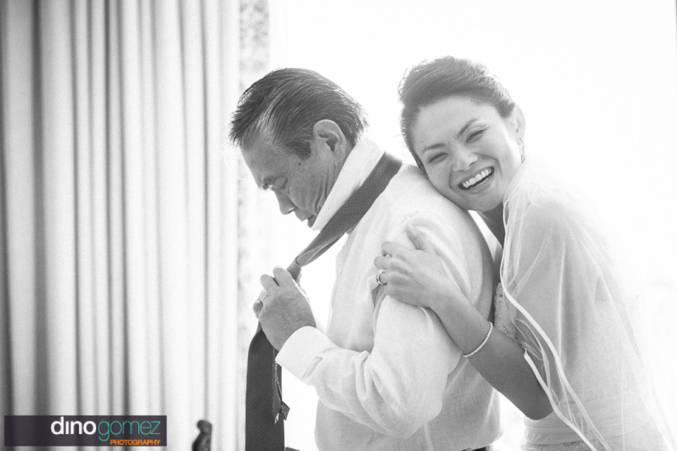 Sweet moment between the bride and the father of the bride as he gets ready for her destination wedding