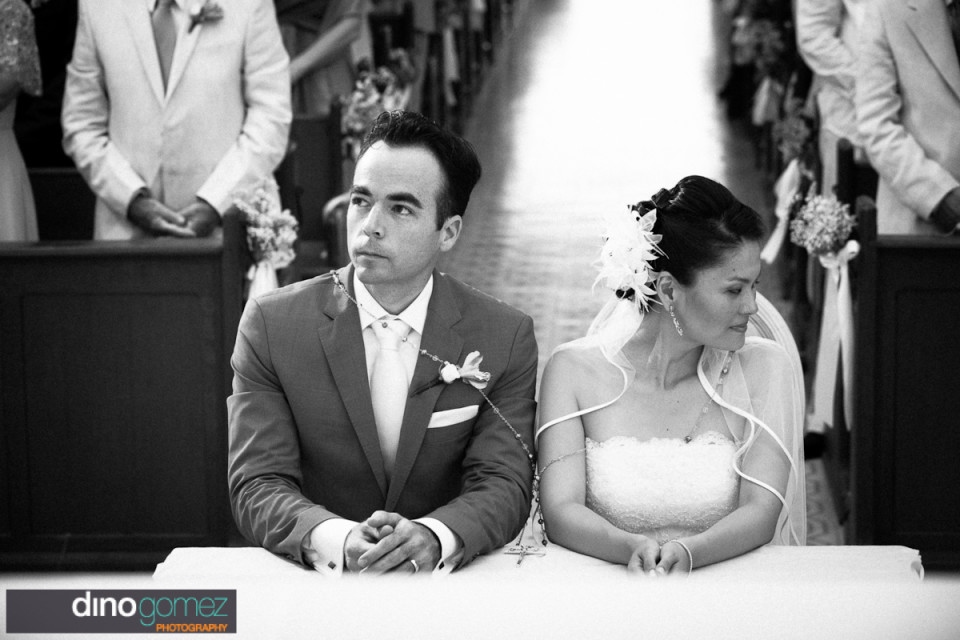 Bride and groom at the altar in a church by destination wedding photographer in Cabo Dino Gomez