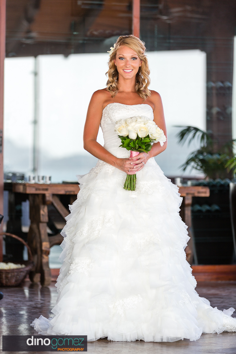 Bridal portrait of the bride holding a bouquet of white roses