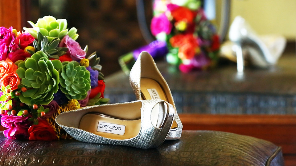 A stunning picture of beautiful Jimmy Choo shoes and colourful wedding flowers