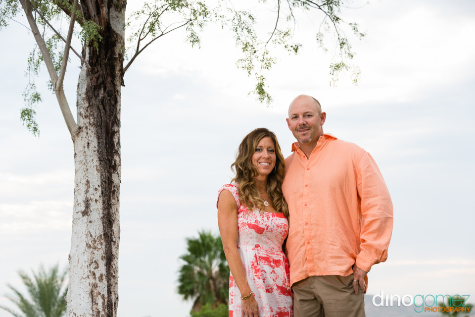 Beautiful photo of husband and wife under a tree in Mexico