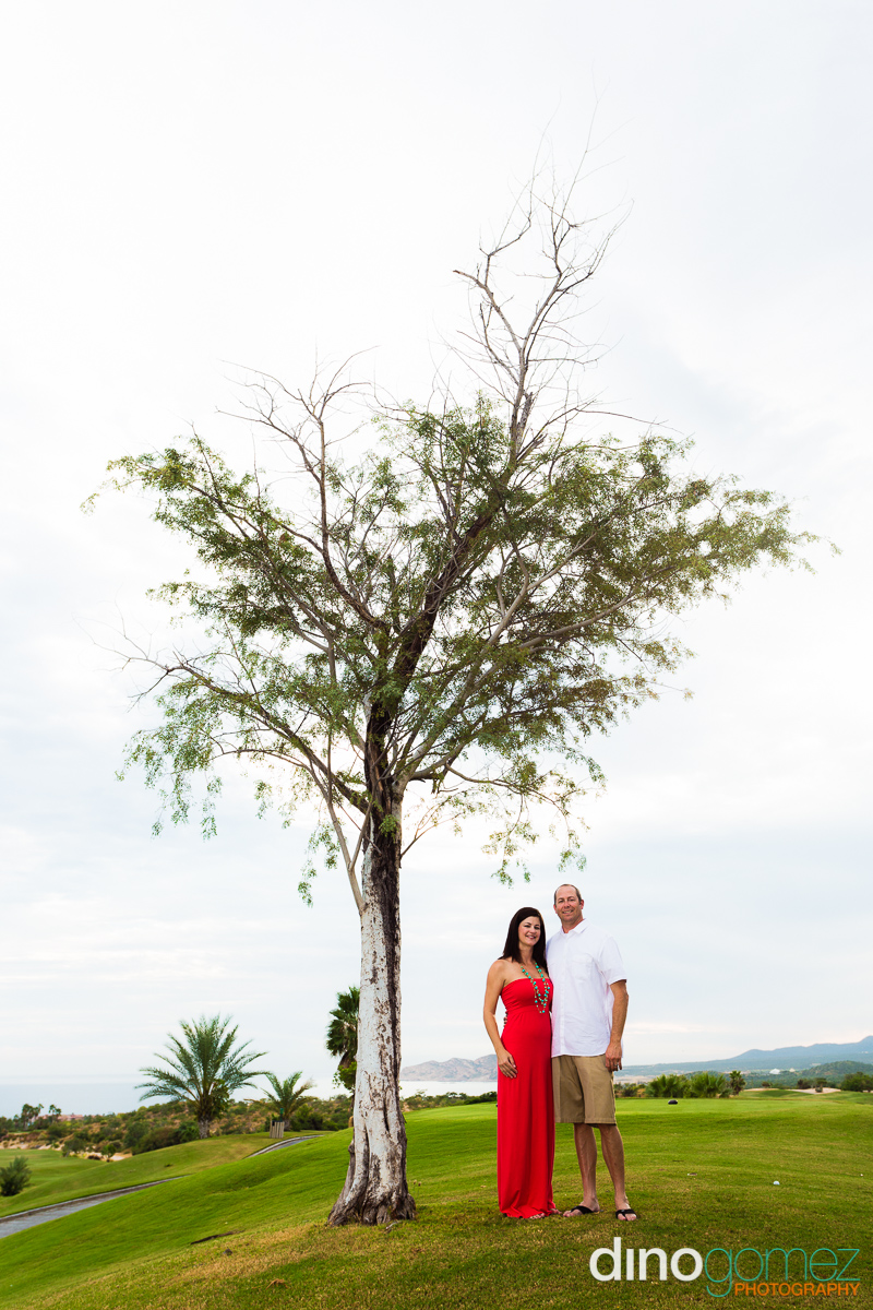A Sweet Shot Of A Husband And His Wife Under A Tree