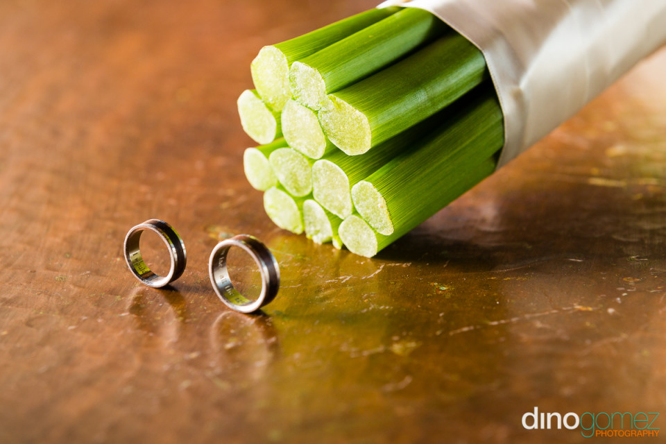 Wedding rings next to flower stems