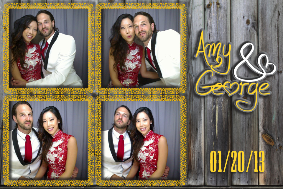 The beautiful bride and groom have a picture taken together in a photo booth. The pictures are set on a weathered wooden back drop.
