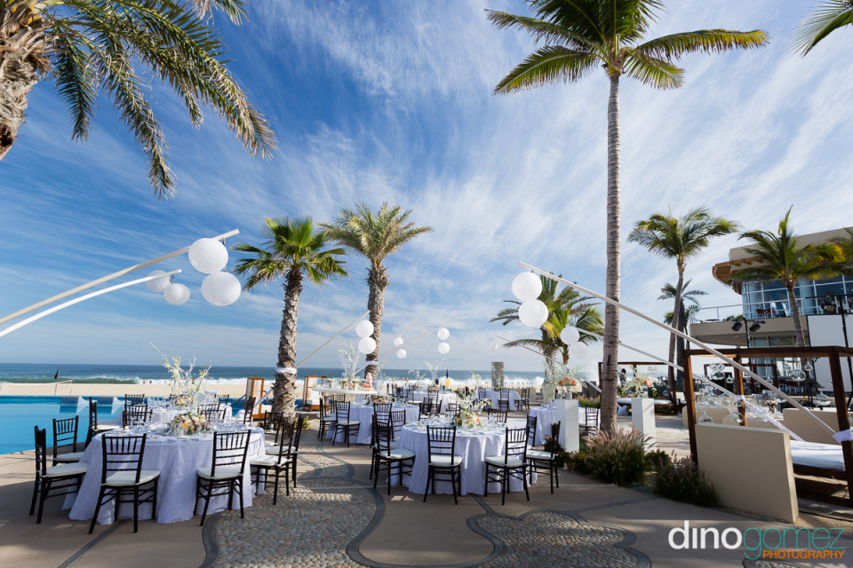 Dreamy poolside dinner wedding reception setup shot by wedding photographer in Cabo Dino Gomez