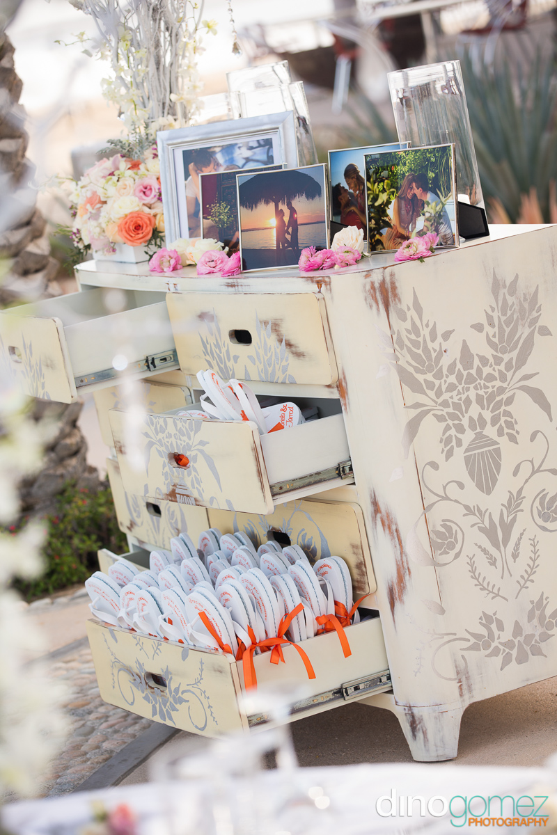 Whimsical wedding decor with shabby chic re-purposed chest of drawers in the fore-front