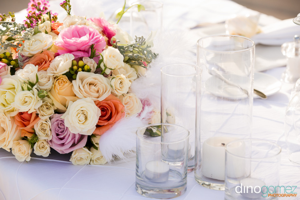 Wedding table decorated with flowers and candles