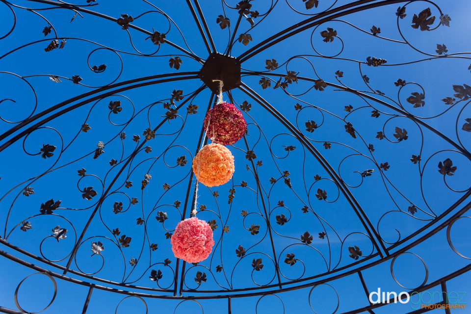 Black iron Gazebo with three colourful ball hanging from the roof