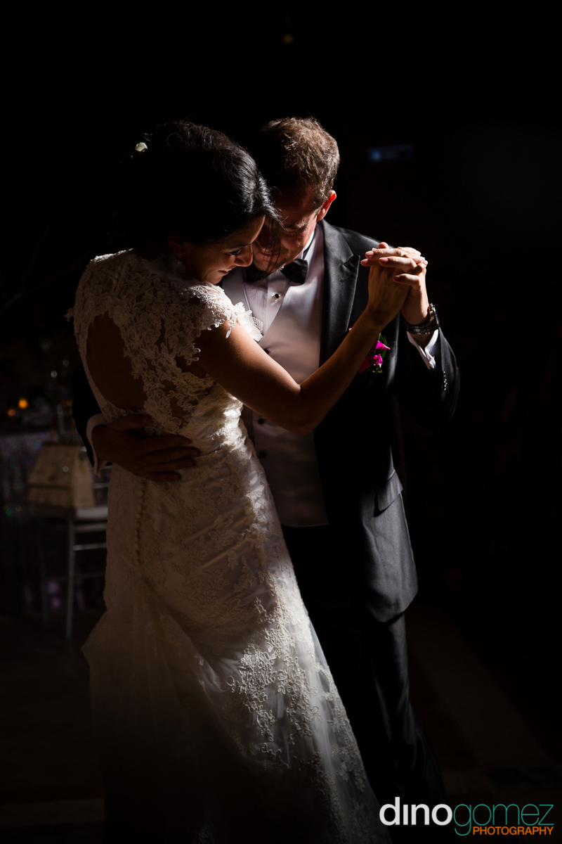 Bride and groom enjoying their first dance together as husband and wife at their destination wedding