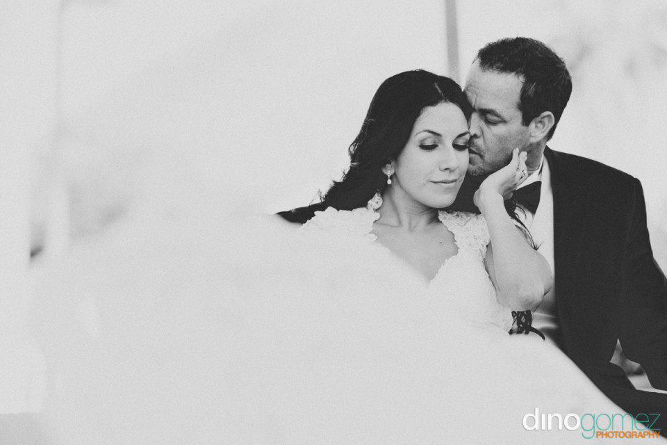 Gorgeous wedding shot of the loving bride and groom in black and white by photographer in Playa del Carmen Dino Gomez