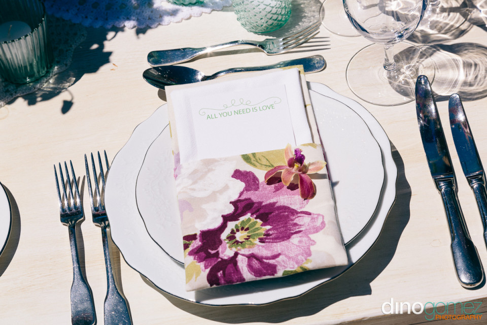 White Plates with a flowery menu/program