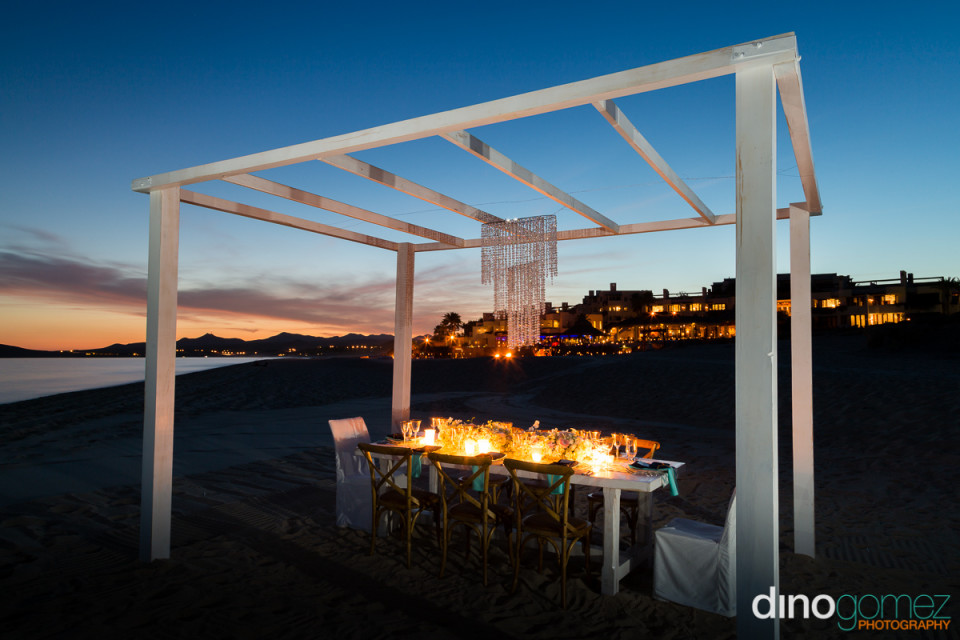 Beautiful wedding trellis dinner setting with lights