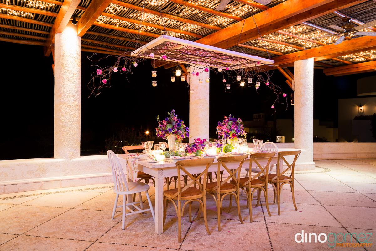 Beautiful beach wedding dinner setting with romantic lighting