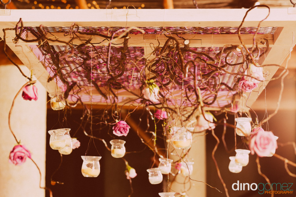 Twines with hanging candles and pink roses