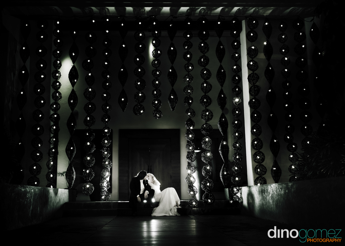 A bride and groom sitting on the stairs in Mexico