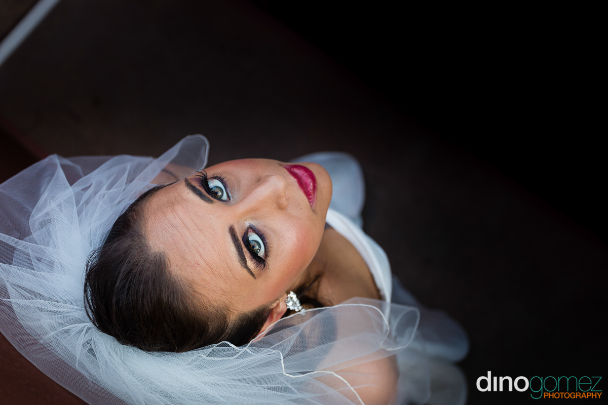 Gorgeous portrait of the bride looking up at her destination wedding in Mexico
