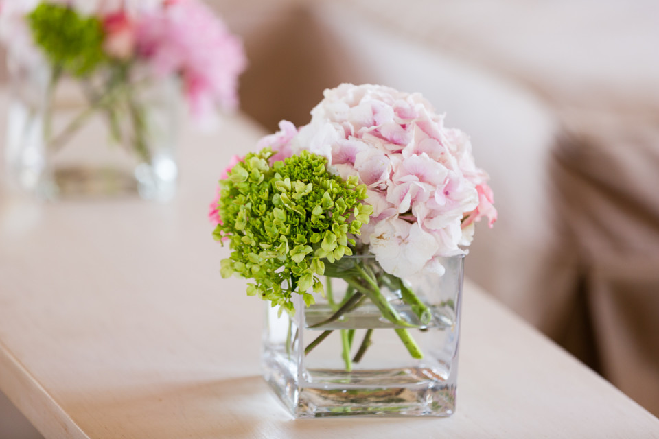 Close Up Of floral arrangement at wedding by Dino Gomez