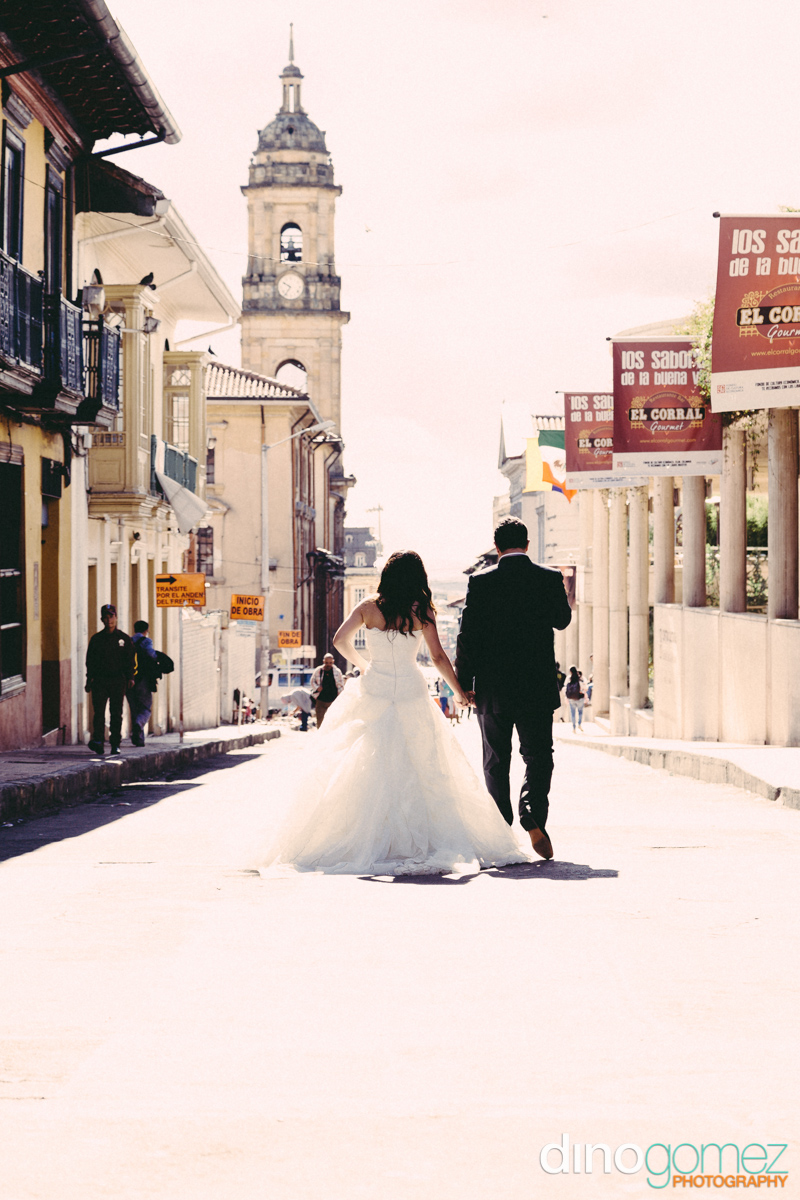 Bride and groom walking through the streets after their destination wedding