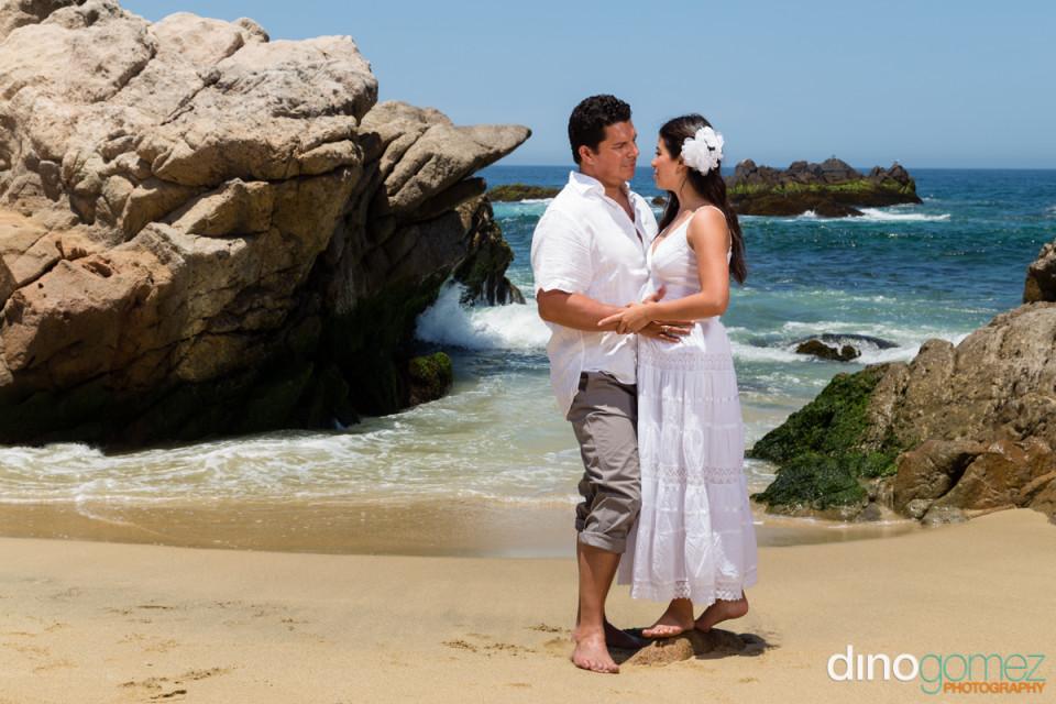Cute couple on the beach in Cancun during their honeymoon