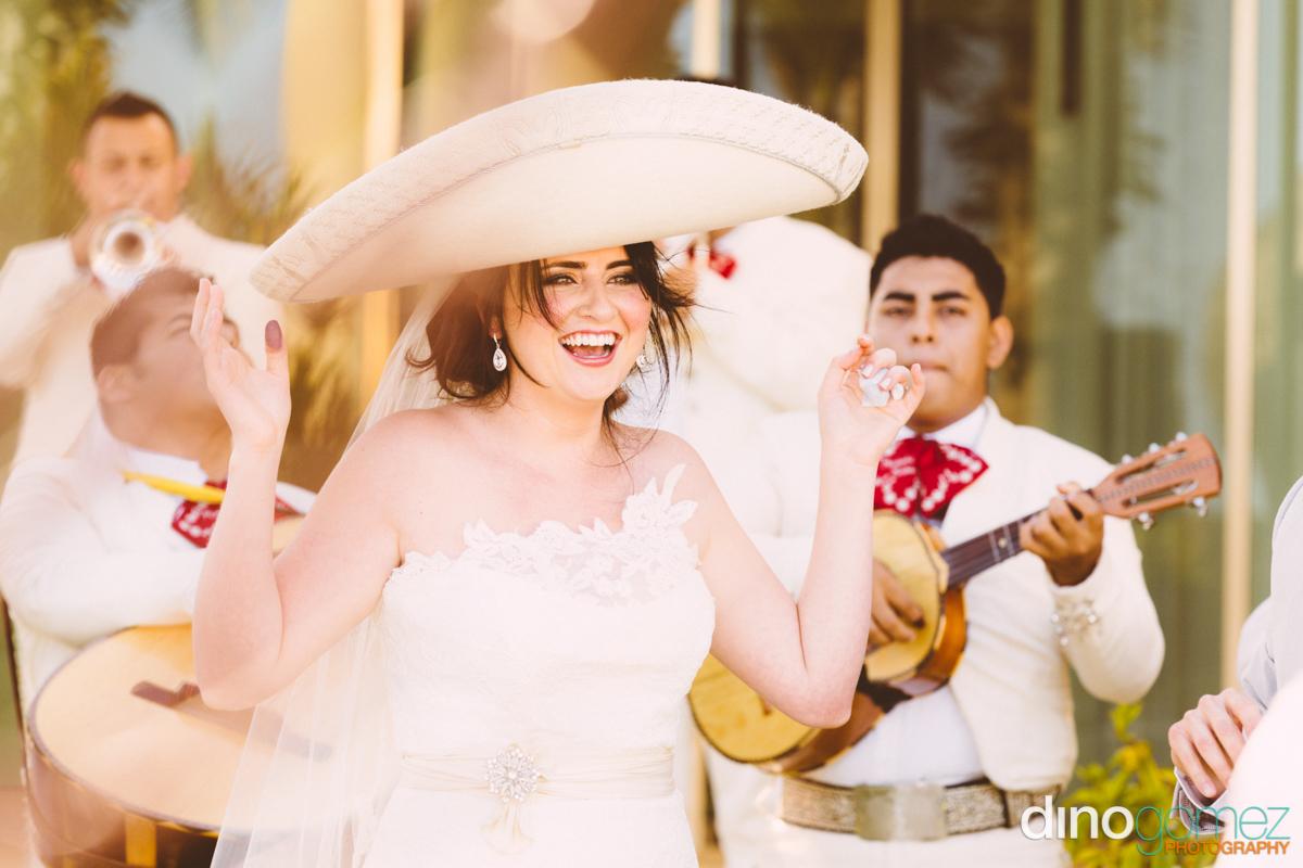 Beautiful bride in a sombrero at her destination wedding in Mexico