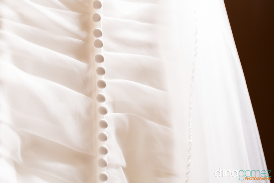 Wedding dress button detail shot by destination wedding photographer Dino Gomez