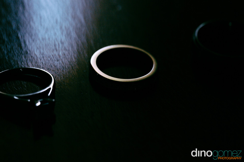 Wedding rings on a black surface