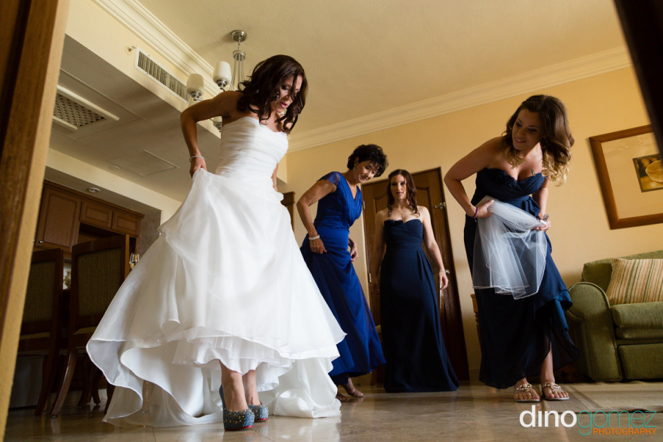 Bride shows off her gorgeous wedding shoes before the wedding ceremony in Mexico