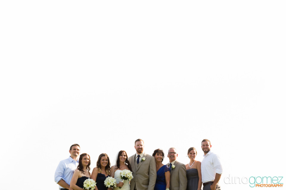 Beautiful shot of the newlyweds and their family after the wedding ceremony in Mexico