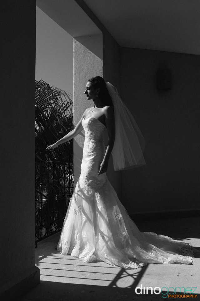 An artistic shot of a bride in black and white on her wedding day by photographer Dino Gomez