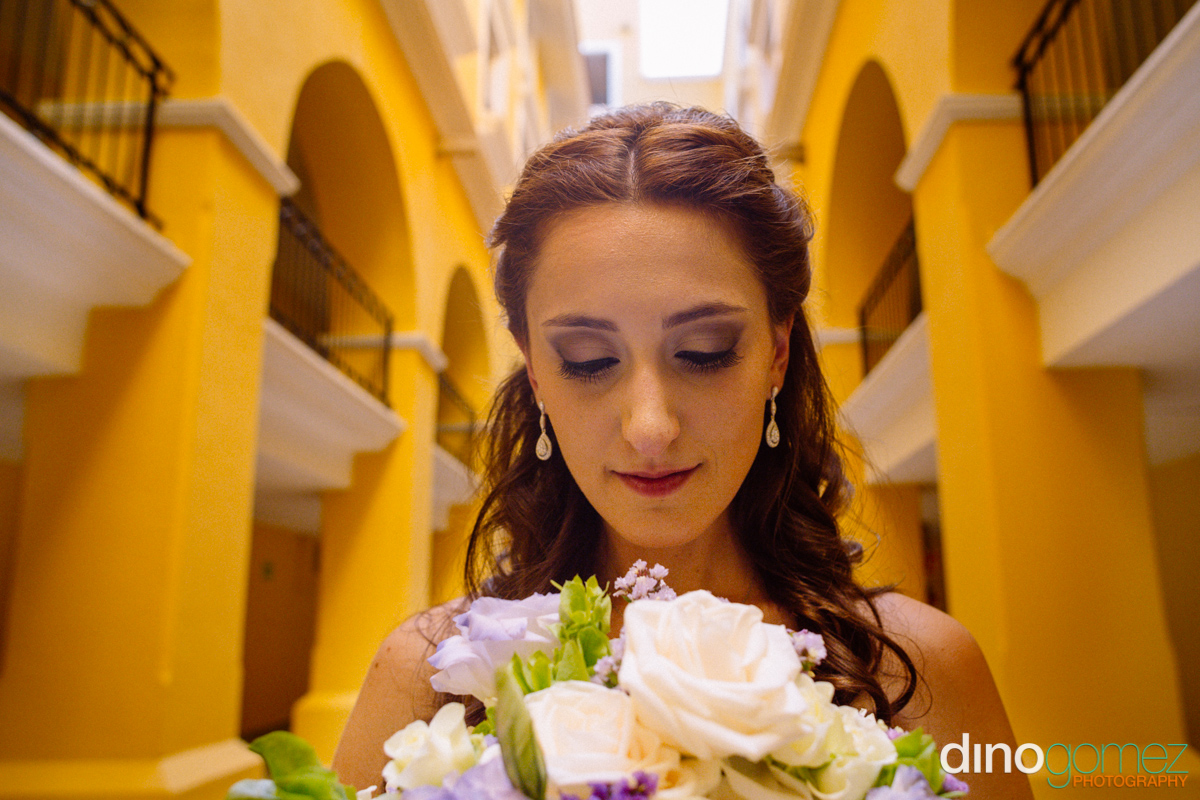 Extreme close-up that really shows off the bride's beautiful face by wedding photographer Dino Gomez