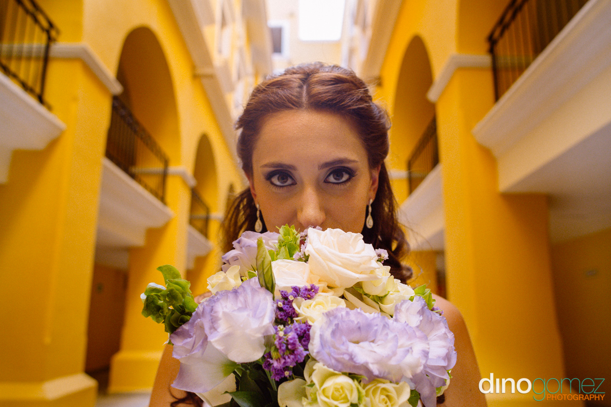 Portrait of the bride smelling the flowers in Mexico