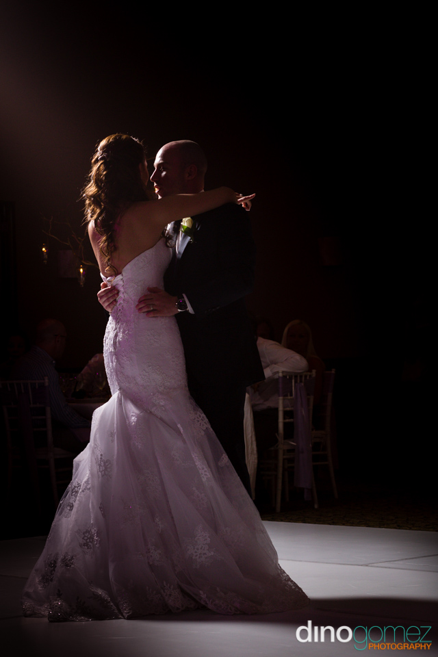 A cute shot of the bride and groom dancing by photographer Dino Gomez