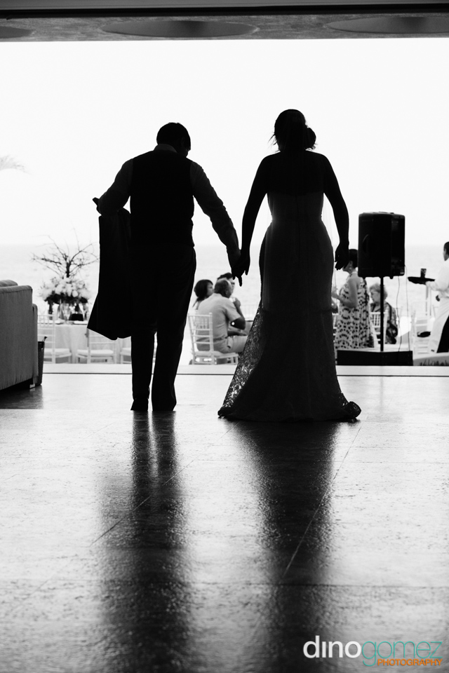 Beautiful Black And White Shot Of The Bride And Groom With The Guests In The Background