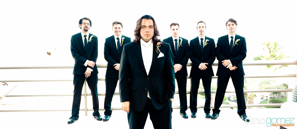 A photgraph of the groom and his groomsmen in matching black suits at a destination Wedding