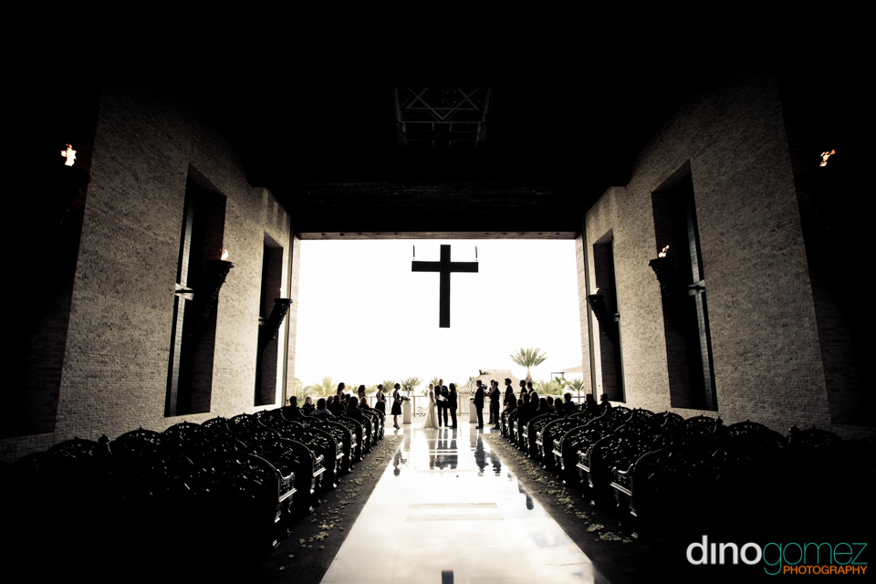 Beautiful and atmospheric shot of the interior of a church during a destination wedding