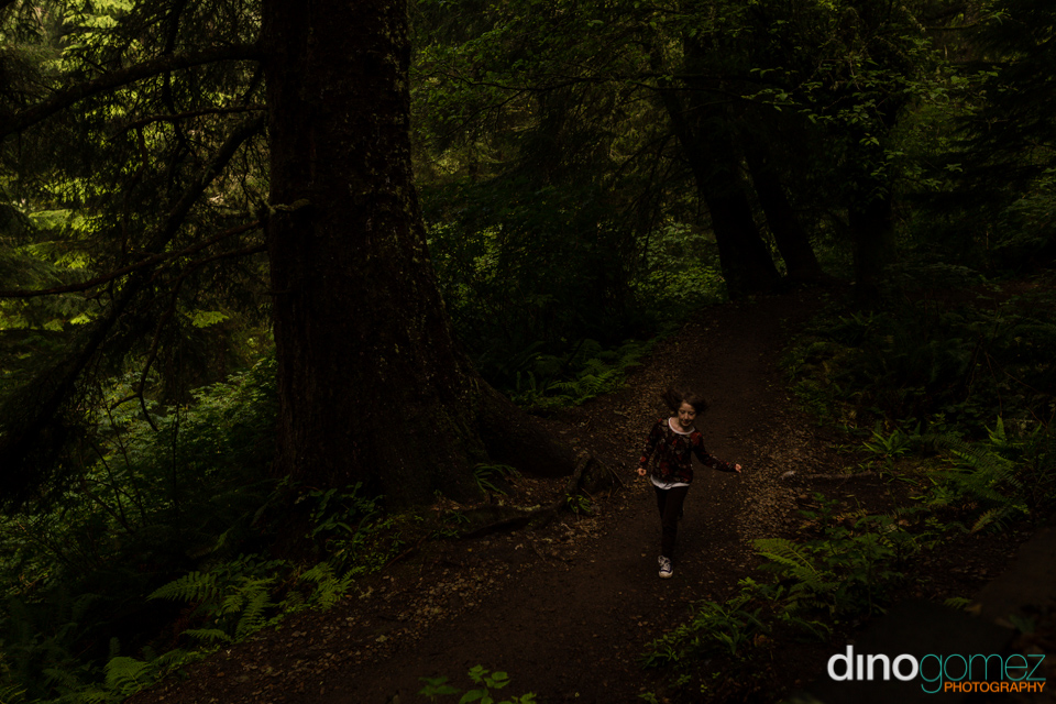 Beautiful girl skipping in the woods in Portland